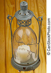 Lantern - Old metal lantern over a wooden background