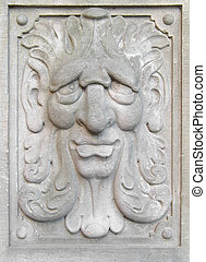 bas-relief as a person fragment of wall of age-old building