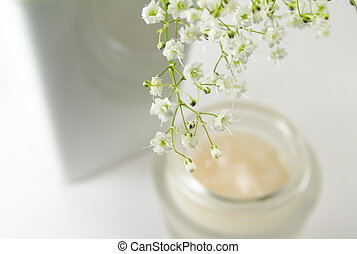 flowers and creme - flowers in vase and face creme