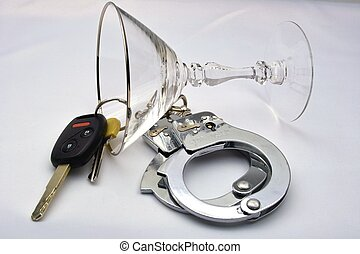Deadly Mix - A glass, car keys, and handcuffs a is great...
