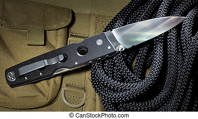 Folding knife - knife that is designed to be used for self...