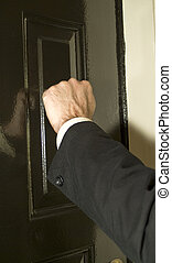 Knocking on the Door - A man knocking on a newly painted...