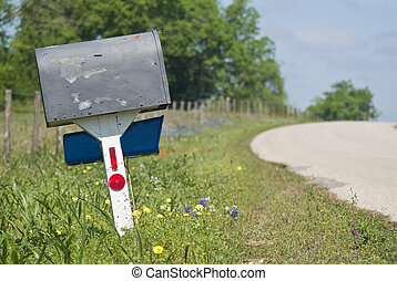 Country Mailbox - An old peeling mailbox by the side of a...