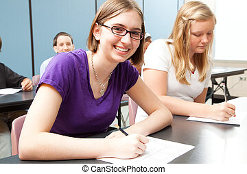 Teens in School - Teenage girls in high school class. Real...