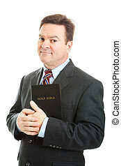 Christian Businessman - Businessman holding the Bible...