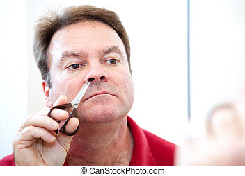 Trimming Nose Hair - Middle aged man trimming his nose hair...