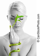 Beautiful woman with bamboo plant - Monochrome picture of a...