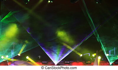 Stage lighted with lasers and bursts of flame