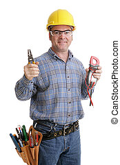 Electricians Tools - Electrician in safety goggles & hardhat...