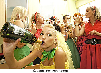 Happy women drinking champagne