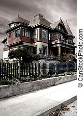 Haunted House - A dramatic image of a Victorian house,...