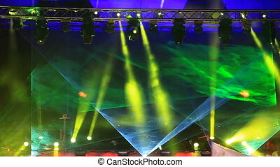 Green laser rays at the discotheque in the open air