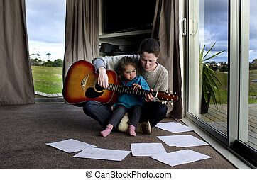 Music lessons - Mother gives her child a music lessons and...