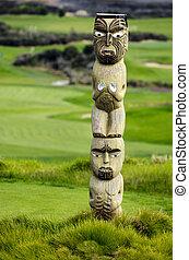 Maori carving in Karikari peninsula, New Zealand.