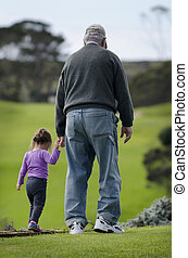 Grandfather plays with grand daughter - Grandfather walks...