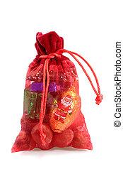 Santa Sack - Red santa sack of christmas sweets on bright...