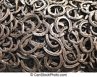 welded horseshoes -  a bunch of welded horseshoes for luck