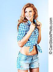 summer clothes - Portrait of a smiling young woman posing...