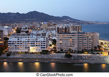 View of town Fuengirola at dusk. Costa del Sol, Andalusia...