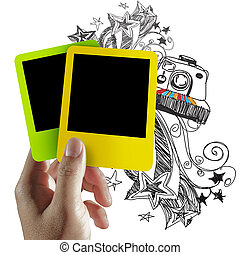 blank colorful photo frame and doodle background - hand hold...