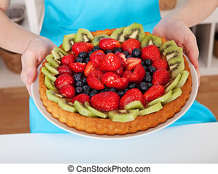 Woman holding self-made cake - Close-up on woman holding...