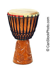 Carved African djembe drum on white background.