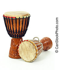 Two African djembe drums - Two carved African djembe drums...