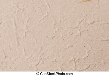 Cream textured paper closeup, can be used as a background