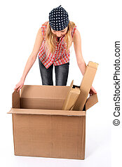 Woman looking into a box