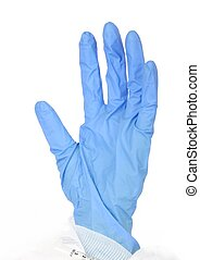 Surgical Glove - A blue rubber glove against a white...