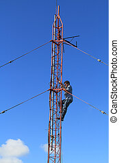 Radio Tower Worker Climbing on a To - Radio tower or mast,...