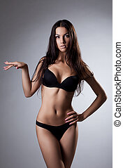 sexy young woman stand in black lingerie - amazing young...