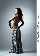 Sexy woman posing in arabian ethnic costume