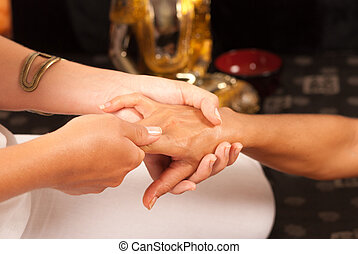 Relaxed hands - Hand being pampered during an oriental...