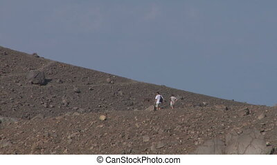 volcano tourist 06 - Tourists walking on an edge of volcano...