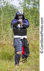 Samurai in armor with katana sword