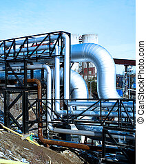 industrial pipelines with insulation against natural blue background