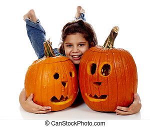Pumkin Carver - Elementary girl hugging two jack-o-lanterns...