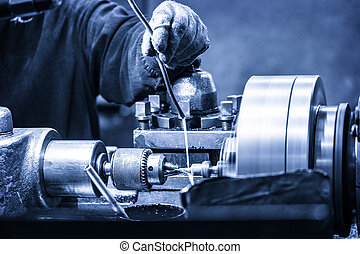 Turning lathe in the workshop in blue