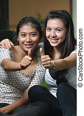 Two girls posing thumb - Two pretty southeast asian girls...