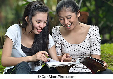 Two Girls Sharing Magazine