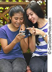 Two Girls with a smart phone