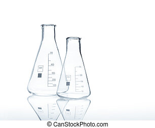 Two empty conical Erlenmeyer flasks with reflection on the...