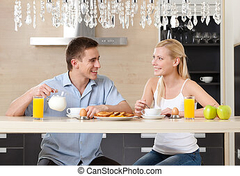 Couple eats in the kitchen