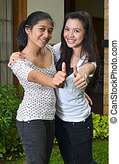 Two Girsl Posing Thumb Happily - Two pretty southeast asian...