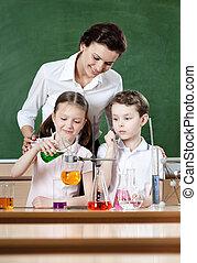 Little pupils study chemical liquids