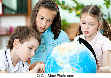 Pupils stare at the school globe - Pupils stare at the...