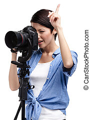 Creative girl-photographer takes shots - Woman takes snaps...