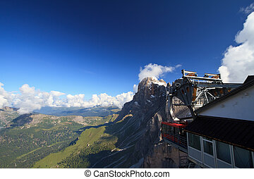 cableway on Dolomites - aerial view of Primiero valley and...