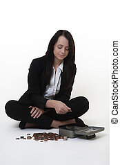 how much - business woman sitting on the floor counting...